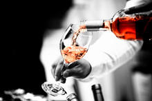 The Waiter Serves Rose, Red And White Wine From The Wine Bottle In The Wine Glass At An Event.