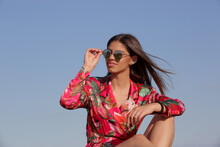 Outdoor Portrait Of Gorgeous Fashionable Brunette Girl Against Clear Blue Sky