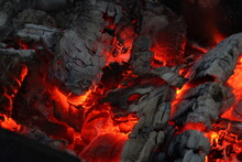 Smoldered Logs Burned In Vivid Fire Close Up. Atmospheric Background With Flame.