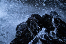 Icey Water Splashing Against The Rocks