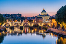Rome Skyline At Sunset With View Of St. Peter's Basilica And Tiber River