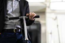 Asian Business Man Passenger Using Smartphone And Holding Electric Scooter Eco Urban Transport. Ecological Transportation Concept