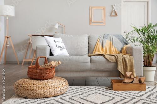 Fotografija Interior of stylish living room with firewood