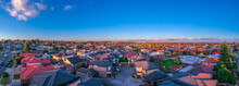Panoramic Aerial Drone View Of Melbournes Suburbs And CBD Looking Down At Houses Roads And Parks Victoria Australia