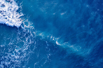 Blue water frothy indonesia ocean surface with big wave. Open sea from aerial top view