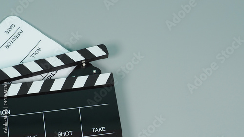 Fotografie, Obraz Black and white Clapperboard or clapper board or movie slate use in video production ,film, cinema industry on gray background