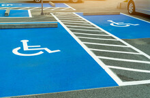 Asphalt Car Parking Lot Reserved For Handicapped Driver In Supermarket Or Shopping Mall. Car Parking Space For Disabled People. Wheelchair Sign Paint On Asphalt Parking Area. Handicapped Parking Lot.