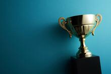 Golden Trophy On Blue Background