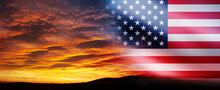 United States Of America Flag On Bright Sky At Sunset Or Sunrise Background.