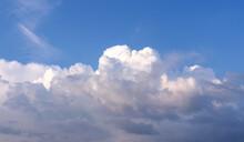 Evening Blue Sky. Big White Clouds