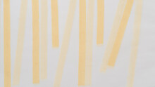 Background With Vertical Stripes Made Of Soft Chalk On Translucent Tracing Paper
