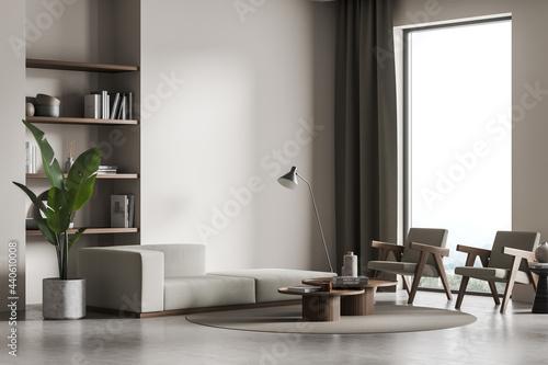 Light living room interior with bookshelf, armchairs and sofa, window and mockup