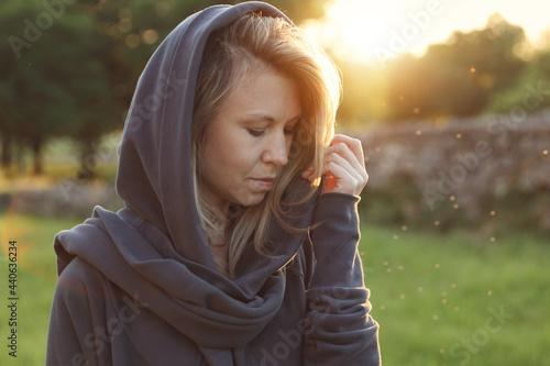 Obraz na plátně Woman in medieval fortress wearing hooded cloak Portrait