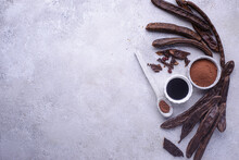 Carob Pods, Powder And Molasses Or Syrup