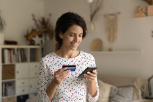 Smiling Woman Paying Online By Credit Card, Using Smartphone, Happy Attractive Young Female Satisfied Customer Making Secure Internet Payment, Shopping Online, Browsing Internet Banking Service