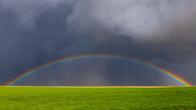 Brilliant Rainbow Shines Underneath Dark Storm Clouds After Violent Storms And Tornadoes Passed Through The Eastern Colorado Plains.