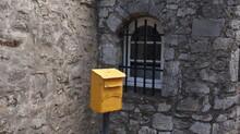 A Yellow Mailbox