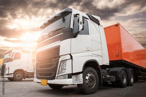 Fototapeta Semi Trucks parking at Sunset Sky