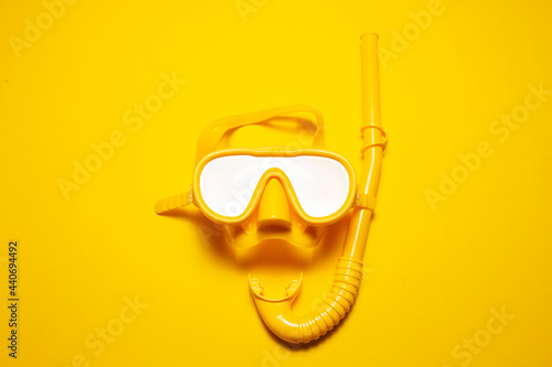 Fotografie, Obraz Studio shot yellow diving mask with snorkel, part of dive equipment isolated on yellow background