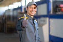 Smiling Mechanic Giving Thumbs Up