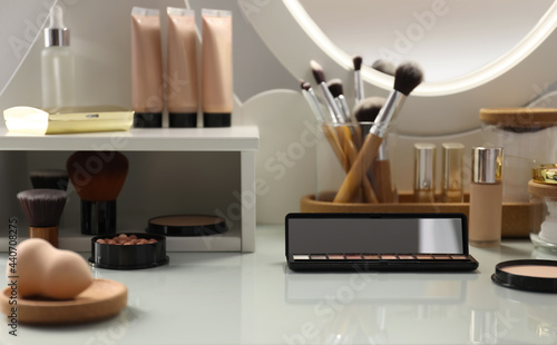 Fotografija Many different cosmetic products on dressing table indoors