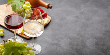 White And Red Wine Glasses, Grape And Appetizer Board