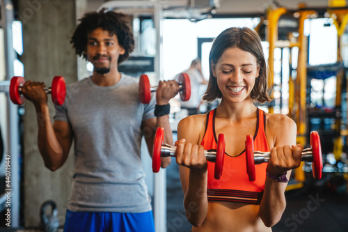 Fotografiet Beautiful fit people working out in gym together