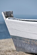 Little Fishing Boat On The Sand Close-up, Water And Sky Background