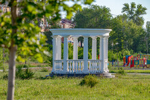 White Decorative Gazebo With Columns In The Park. Soft Focus
