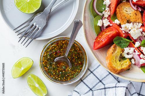 Fotografie, Obraz Mustard, olive oil and dill salad dressing in glass jar