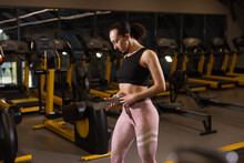 Sporty Woman Fastens The Gym Belt