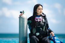 Asian Woman In Scuba Diving Gear.