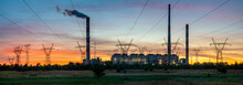 Power Plant And High Voltage Pylons Against The Background Of The Evening Sky