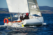 Two Skippers Sailing On Yacht