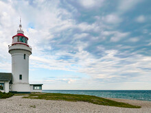 The Lighthouse On The Beach. The Lighthouse - Sletterhage Fyr Was Built In 1894 And Is Still Working In Denmark Today