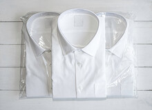 White Shirt Folding In The Package On Wooden Background.