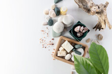 Body Care Items, Stack Of Round Stones, Sea Salt, Salt Soap, On A White Background Top View, Empty Space For Text
