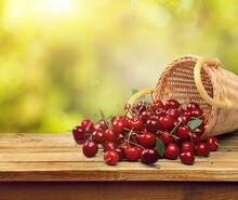 Tasty Fresh Ripe Cherries In A Basket On A Table