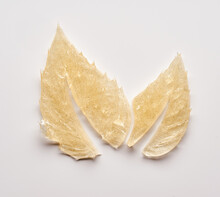 Transparent Smear And Texture Of Golden Cosmetic Gel On A White Background.