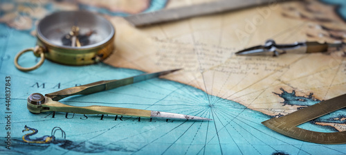 Fotografiet An old geographic map with navigational tools: compass, divider, ruler, protractor