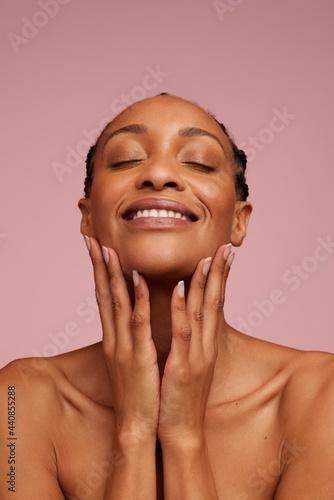 Fototapeta Beautiful radiant dark skin.