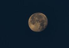 Full Moon Isolated On A Dark Blue Night Sky