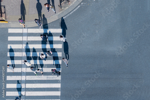 top aerial view of blur men and women people in winter cloth and business dress walk across crosswalk in street Fotobehang