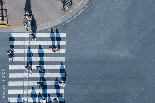 Canvas top aerial view of blur men and women people in winter cloth and business dress walk across crosswalk in street