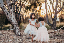 Sisters Holding Hands At The Park, Sisters Dancing At The Park, Two Girls At The Park