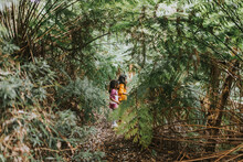 Two Little Girls In The Forest