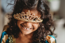 Curly Haired Girl Smiling With The Tiara On Her Face