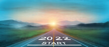 New Year 2022 Or Start Straight Concept. Word 2022 Written On The Road In The Middle Of Asphalt Road At Sunset. Concept Of Planning And Challenge, Business Strategy, Opportunity And New Life Change