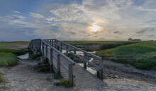 View Of Of Salt Marsh, Mud Flat And Bridge Over Marsh Channel In Sankt Peter Ording At The Südstrand.