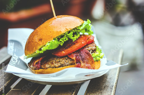 Fotografia, Obraz Double cheeseburger with French fries and bacon